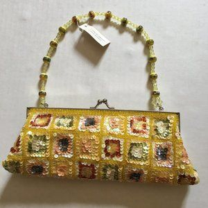 Beads, embellishments and multi-color yellow purse